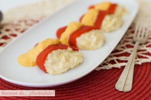 Pimientos del piquillo rellenos de bacalao con salsa de pimientos