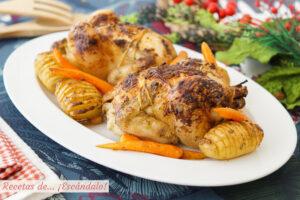 Picantones al horno con patatas hasselback y zanahorias baby